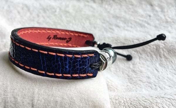 Blue ostrich leather bracelet with handmade red stitches