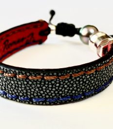 Grey stingray bracelet with blue et brown stitches
